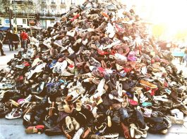 a huge pile of old shoes