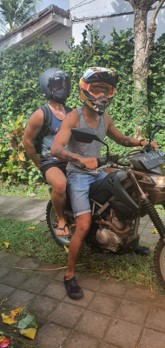 Image of driving a motorcycle with Vivobarefoot Primus Lite